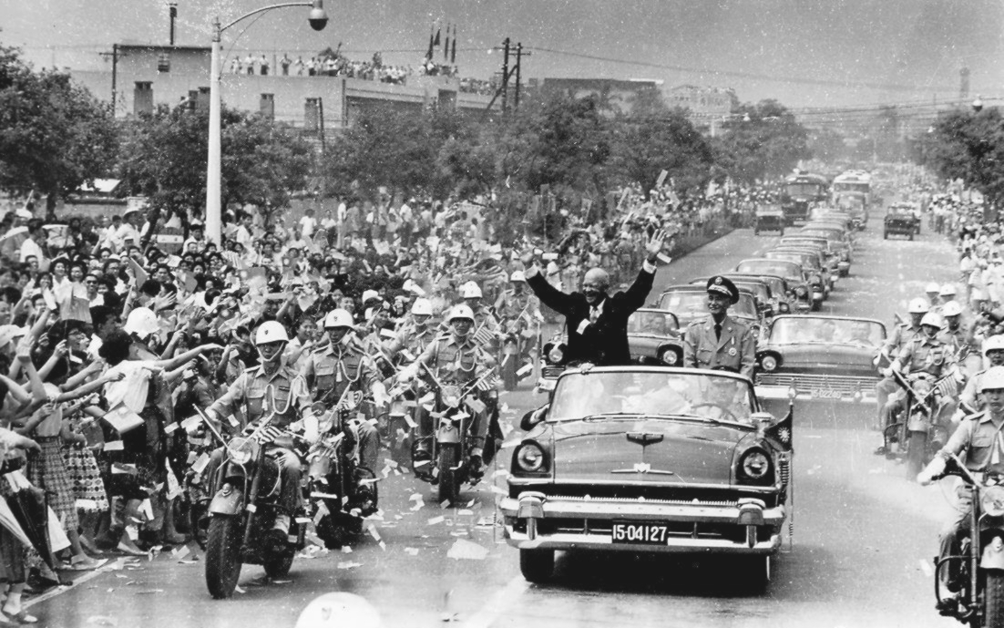 With Chiang Kai-shek, President Dwight D. Eisenhower waved to crowds during his visit to Taipei in June 1960.