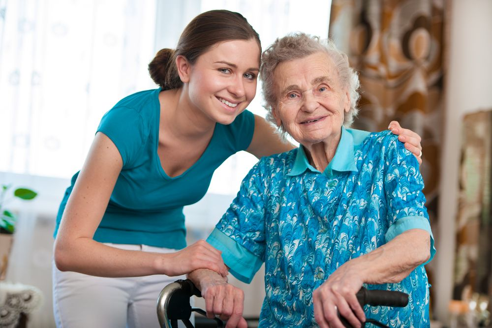 Young Nurse With Elder Lady