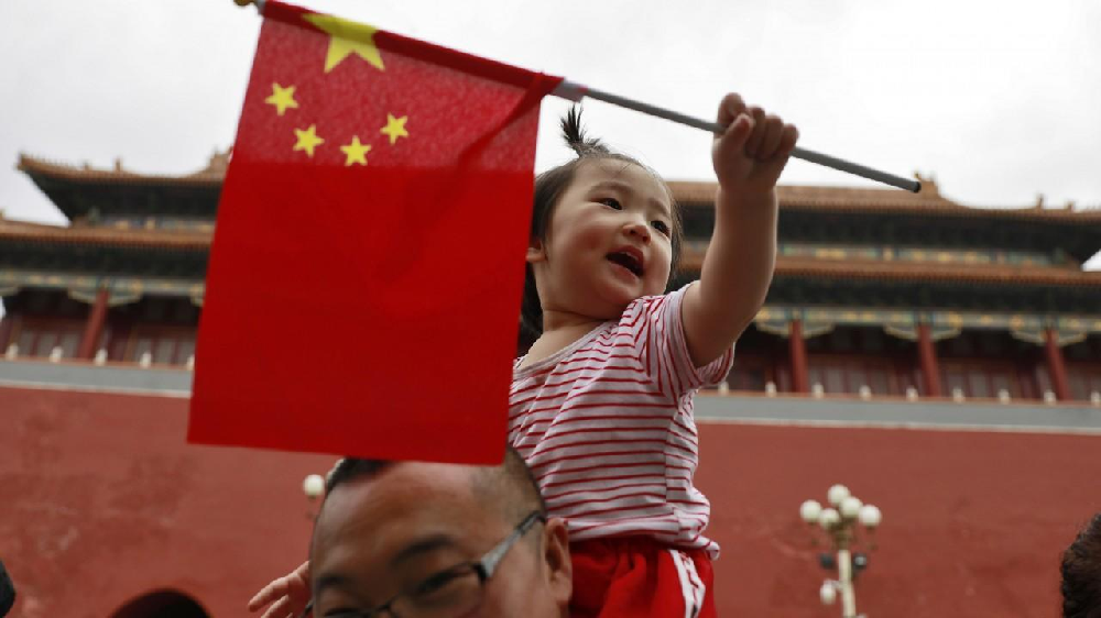 Chinese Girl Holding A Chinese Flag