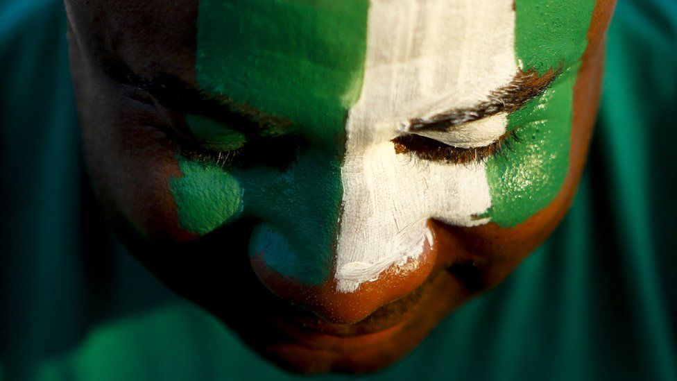 Nigerian With Flag Painted On Face
