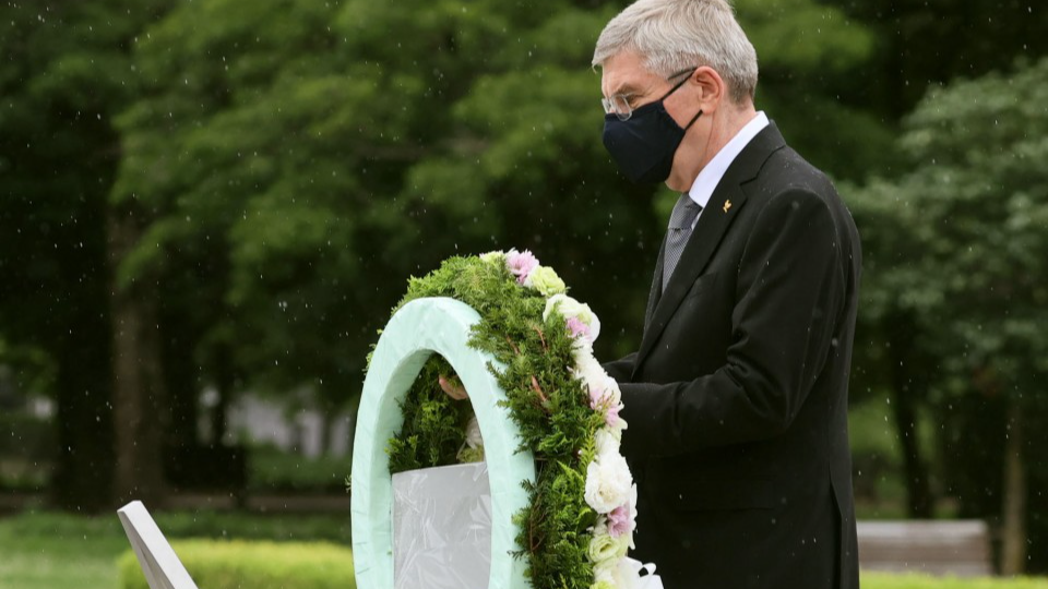 International Olympic Committee President Thomas Bach offers flowers at the cenotaph for atomic bomb victims at Hiroshima's Peace Memorial Park on July 16, 2021, a week before the opening ceremony of the Tokyo Olympics. (Pool photo)(Kyodo) ==Kyodo