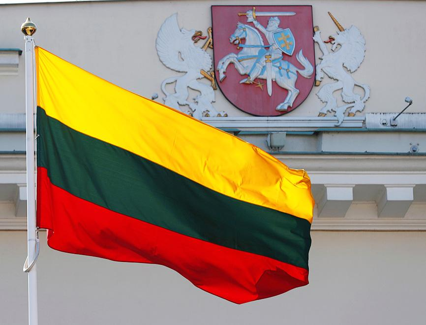 The Lithuanian flag flutters in Vilnus on March 30, 2019, during the 15th anniversary celebration of Lithuania's membership in NATO.
