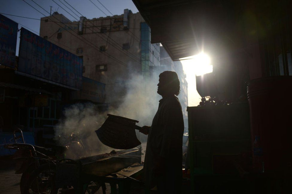 An Afghan street vendor in Mazar-i-Sharif. The city is home to a small community of Uyghurs.