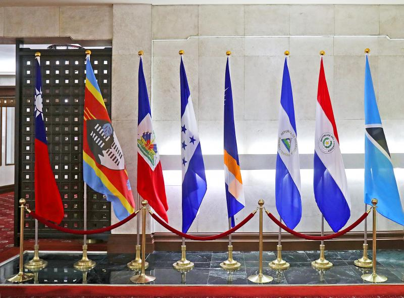 The national flag of Honduras, fourth left, along with the flags of Taiwan, left, and some of Taiwan's other diplomatic allies are displayed in a hall at the Ministry of Foreign Affairs in Taipei on Sept. 16, 2019.