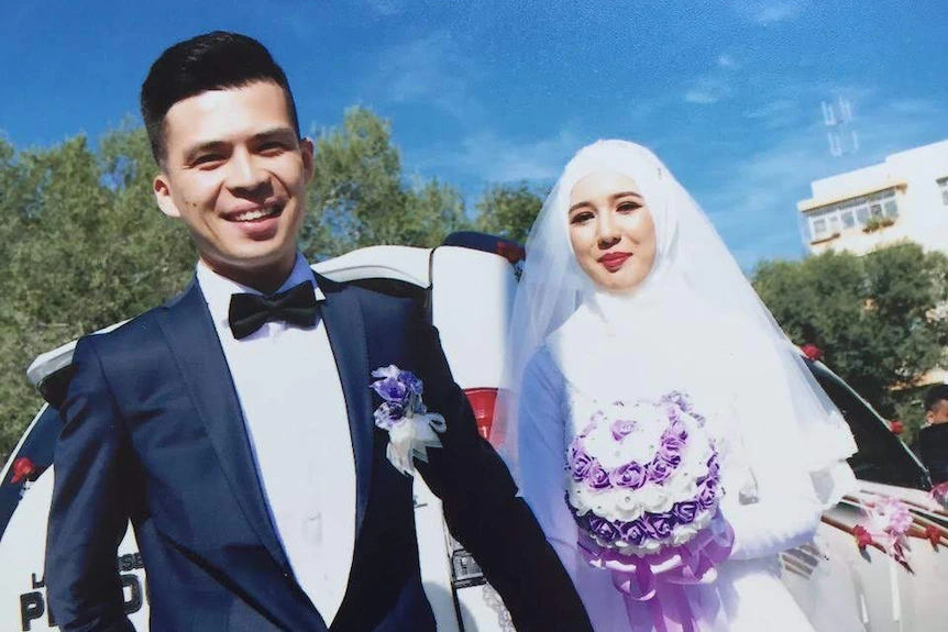 Ms Mezensof and her husband Mr Taher on their wedding day in Xinjiang.