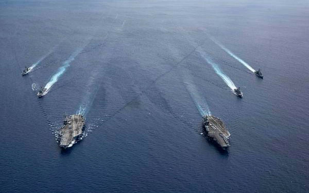 Keeping watch: The USS Ronald Reagan and USS Nimitz in formation, in the South China Sea, in this file photo.     Photo Credit: PETTY OFFICER 3RD CLASS JASON TARLETON