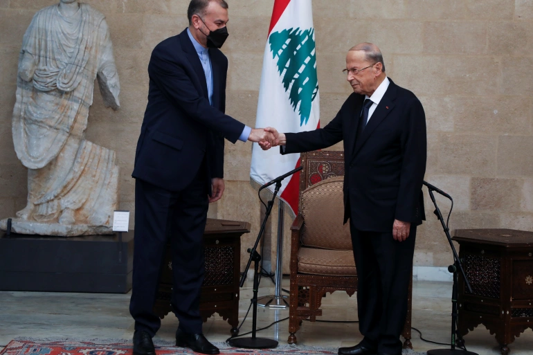 Iranian Foreign Minister Hossein Amir-Abdollahian shakes hands with Lebanon's President Michel Aoun at the presidential palace in Baabda, Lebanon (Reuters)