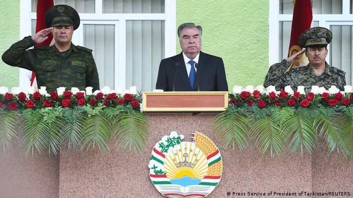Tajik President Rakhmon (c) attended a military parade at the Afghan border Thursday as ally Russia called for calm